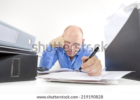Overworked and exhausted businessman - stock photo