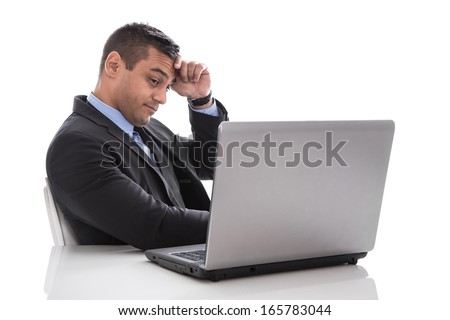 Overworked and stressed businessman isolated on white with laptop. - stock photo