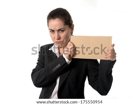 overworked angry business woman in stress wearing a business suit holding a blank sign as copy space on a white background  - stock photo