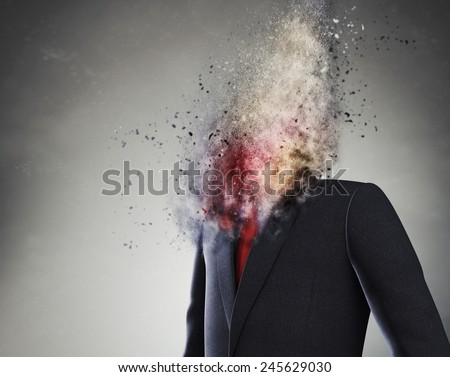 Overworked  businessman standing headless with explosion instead of his head - stock photo