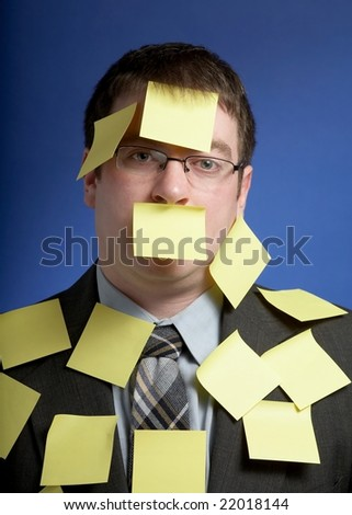 Overworked businessman with yellow sticky reminder notes - stock photo