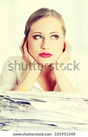 Overworked businesswoman - stock photo