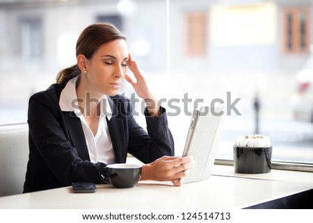 Overworked businesswoman in a coffee shop