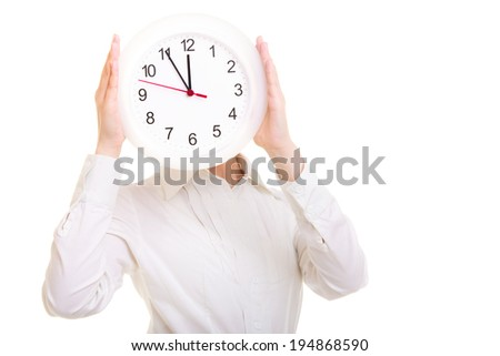 Overworked businesswoman showing clock. Busy woman covering her face isolated on white. Time management. Studio shot.