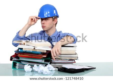 Overworked engineer - stock photo