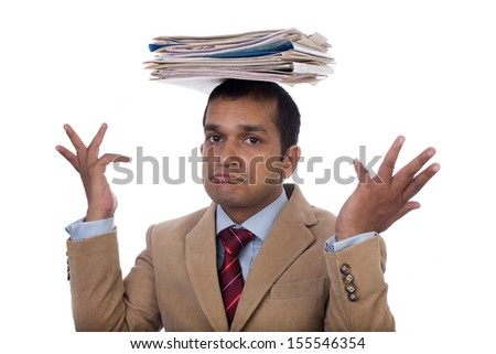 Overworked Indian businessman or executive displaying Expressions of despair, boredom and burnout. Isolated on white background. - stock photo