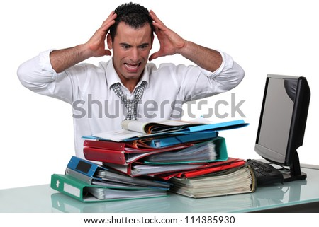 Overworked office worker - stock photo