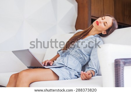 overworked woman sleeping with laptop - stock photo