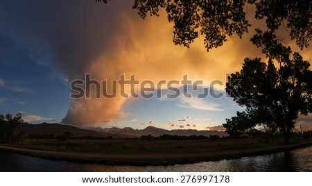 owens valley sunset over an irrigation canal - stock photo