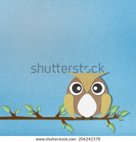 owl perched paper craft on paper background  - stock photo