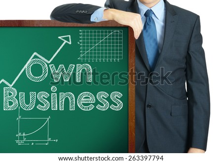 Own business on blackboard presenting by businessman  - stock photo