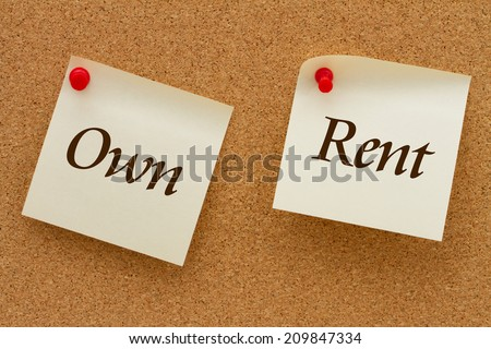 Own versus Rent, Two yellow sticky notes on a cork board with the words Own and Rent - stock photo
