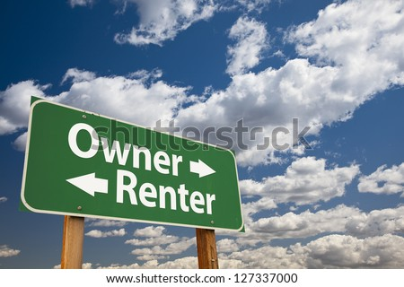 Owner, Renter Green Road Sign Over Dramatic Clouds and Sky. - stock photo