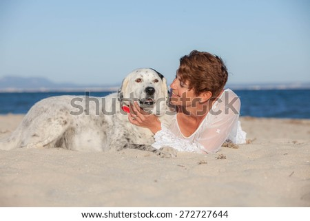 owners and dogs relaxing on holiday - stock photo