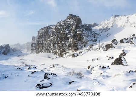 Oxararfoss waterfall in the rift of continental plates, Pingvellir valley. Winter view. Thingvellir National Park. Iceland