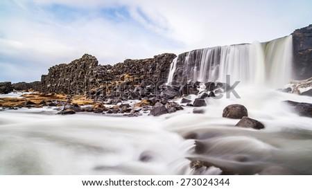 Oxararfoss waterfall in Thingvellir National Park, reykjavik, Iceland - stock photo
