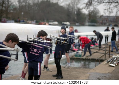 OXFORD - MAR 8: Oxford university students preparing a boat during Torpids races on March 8, 2013. Torpids are one of annually three races with more than 1,200 participants. - stock photo