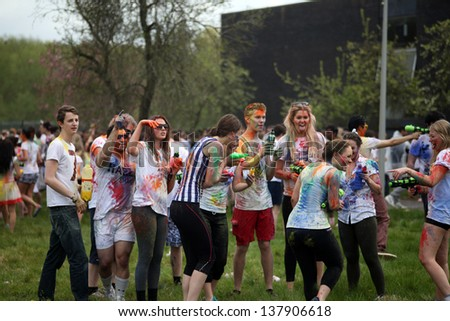 OXFORD - MAY 5: Oxford University students covered in color during Oxford Holi festival on Sunday May 5, 2013 in Oxford, United Kingdom. - stock photo