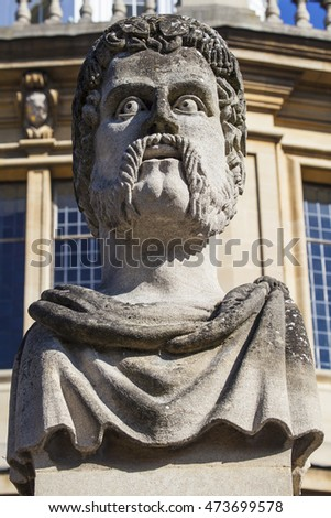 OXFORD, UK - AUGUST 12TH 2016: One of the Emperor Head sculptures situated outside the Sheldonian Theatre in the historic city of Oxford, on 12th August 2016.