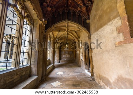 OXFORD, UK - JULY 19, 2015: Old corridors of Christ Church, University of Oxford, England. It is part of the original Priory of St Frideswide which stood before the college was built. - stock photo
