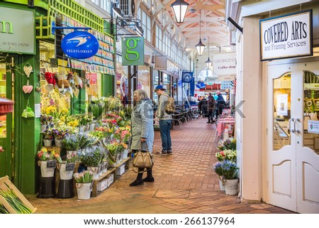 OXFORD, UK - MARCH 27, 2015: Shoppers enjoy the quaint stalls in The Covered Market, Oxford, which was officially opened on 1 November 1774 and is still active today. - stock photo