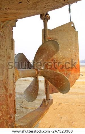 oxidation rusty fishing boat propeller, closeup of photo - stock photo