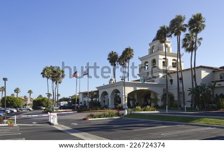 OXNARD, CA - AUGUST 21, 2014: Clean swept parking lot and hotel main entrance ready for arriving guests, Embassy Suites Mandalay Beach Hotel & Resort in Ventura county, Southern California - stock photo