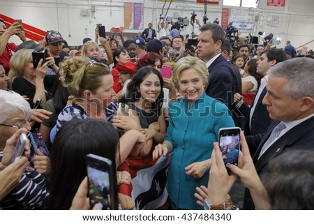 "OXNARD, CA - JUNE 04, 2016: photographers scamper to photograph Hillary Clinton and Democratic Presidential Candidate at a ""Get out the vote"" rally at Hueneme High School in Oxnard, California. - stock photo"