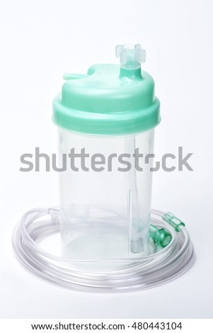 Oxygen therapy system humidifier bottle with tubing.