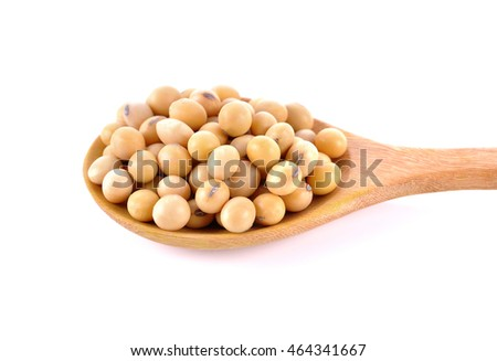 oybeans in wooden spoon on white