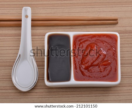 Oyster sauce and ketchup on the table  - stock photo