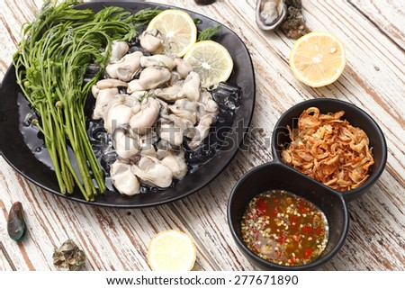 Oyster seafood lemon fresh asia  fried shallots sauce  mussel asia appetizer luxury - stock photo