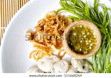 oyster with spicy sauce - stock photo
