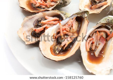 oysters baked with bacon - stock photo
