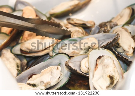 Oysters in a bowl in a restaurant - stock photo