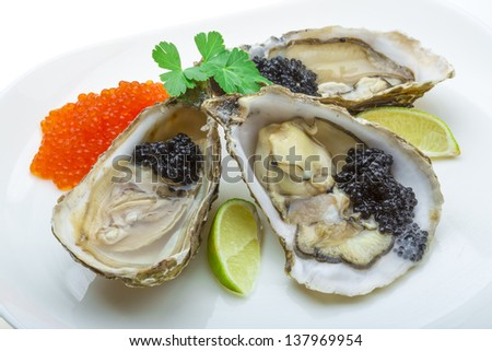 Oysters with black cavair - stock photo