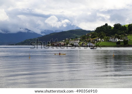 OYSTESSE, NORWAY - JULY 2, 2016: This view of the town Oystesse, located on the shores of Hardangerfjord.