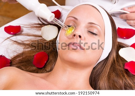 Ozone treatment on face at the beautician. - stock photo