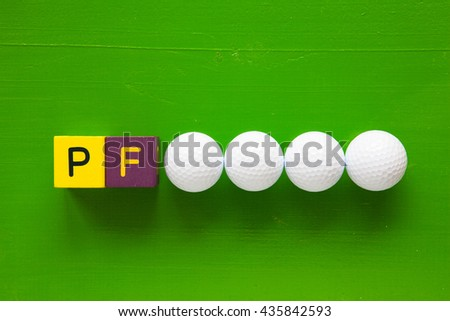 P.F. - an inscription from children's wooden blocks and golf ball