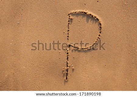 P text written in the sandy on the beach - stock photo