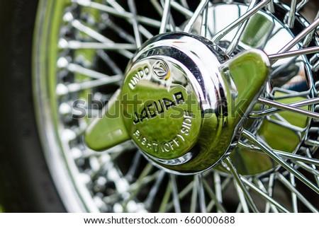 paaren im glien germany june 03 hubcap of sports car jaguar