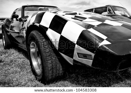 "PAAREN IM GLIEN, GERMANY - MAY 26: The Chevrolet Corvette C3 (Black and White), ""The oldtimer show"" in MAFZ, May 26, 2012 in Paaren im Glien, Germany - stock photo"