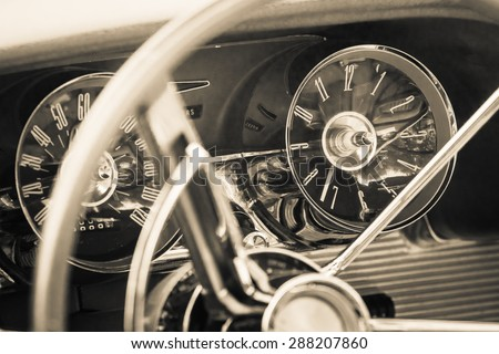 PAAREN IM GLIEN, GERMANY - MAY 23, 2015: The dashboard of a personal luxury car Ford Thunderbird (third generation). Vintage toning. Stylization. The oldtimer show in MAFZ. - stock photo
