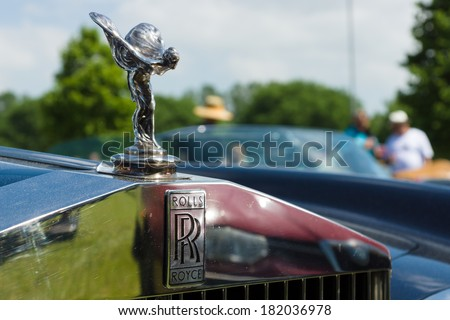 """PAAREN IM GLIEN, GERMANY - MAY 19: The famous emblem """"Spirit of Ecstasy"""" on a Rolls-Royce Corniche, The oldtimer show in MAFZ, May 19, 2013 in Paaren im Glien, Germany - stock photo"""