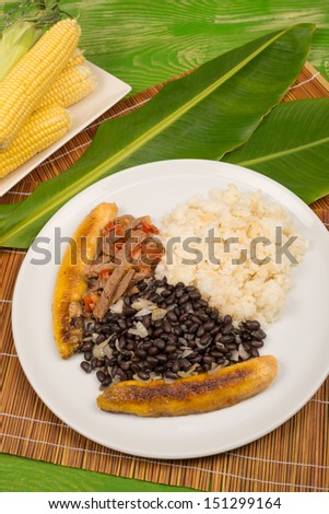 Pabellon criollo, a Venezuelan classic gathering some of the basic Latin American food staples