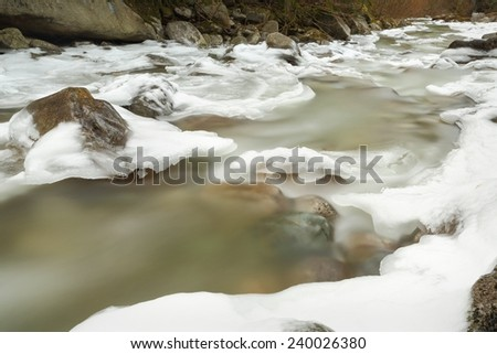 Pacific Northwest, Icy Winter River. An icy winter river in the Pacific Northwest.  - stock photo