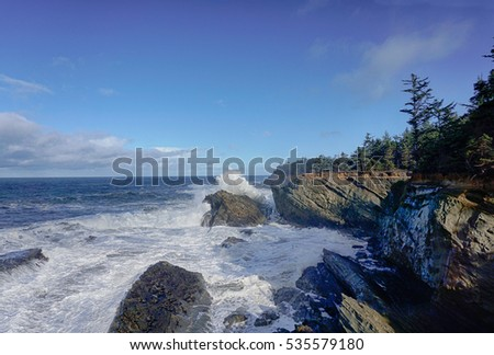 Pacific Ocean crashing against the shore on the Oregon coast at Shore Acres
