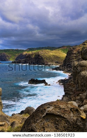 Pacific ocean waves hitting the rocky coastline of Maui, Hawaii, USA