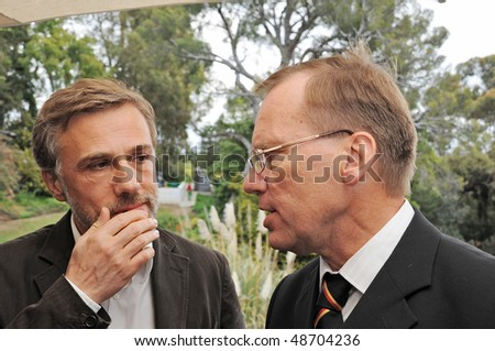 PACIFIC PALISADES - MARCH 7: Actor Christoph Waltz(L) and German Consul General Wolfgang Drautzt(R) talk at The German Consulate and the Goethe Institute fete German nominees at Villa Aurora on March 7, 2010 in Pacific Palisades