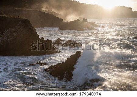 Pacific waves crash into the rocky northern California coastline north of San Francisco. - stock photo